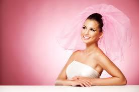 Tan bride in wedding dress